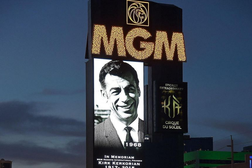 The marquee at MGM Grand Hotel & Casino displays a video tribute (far left) to the late Kirk Kerkorian (left), who founded MGM Resorts International and was its largest shareholder.