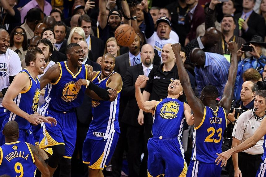 Above, the Golden State Warriors team made sure they did not throw away their 3-2 series lead in Cleveland and held off the Cavaliers to take Game Six, and the NBA crown. Left, Stephen Curry and Finals MVP Andre Iguodala (with towel) foiled LeBron Ja