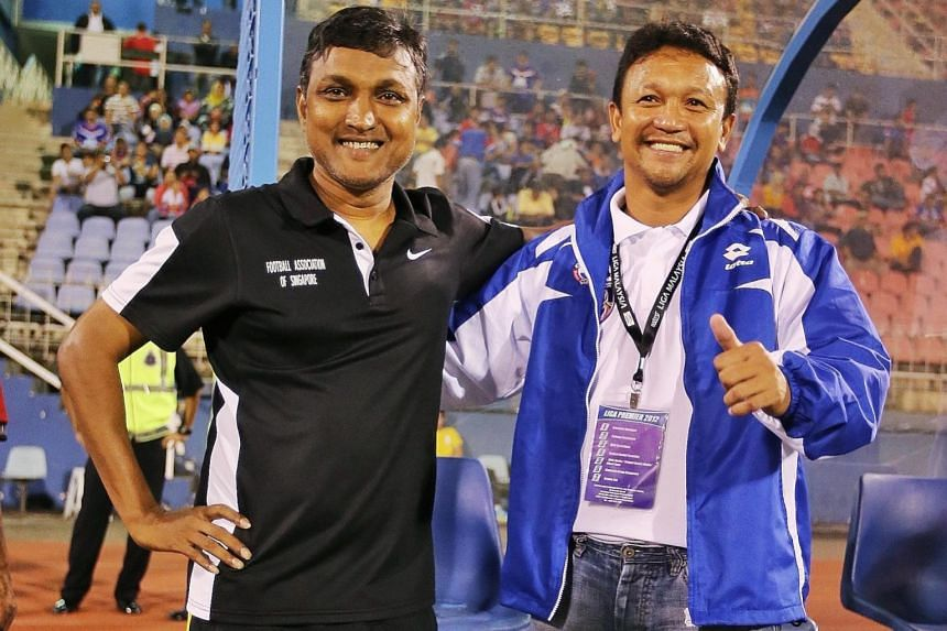 Sundram (left) and Fandi have forged a successful coaching partnership. Goalie Izwan Mahbud rose to the occasion repeatedly to thwart the Japanese attackers - including Shinji Okazaki (centre) and Yuya Osako - on Tuesday. His Lions team-mates made su