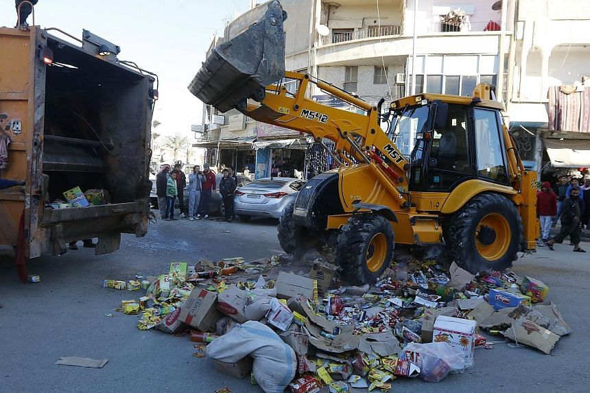 Confiscated products in central Raqqa are disposed of by men who say they were hired by ISIS to monitor the quality of goods in markets. Residents of ISIS-controlled areas do not describe easy lives, but some want the hardliners to stay, reflecting t