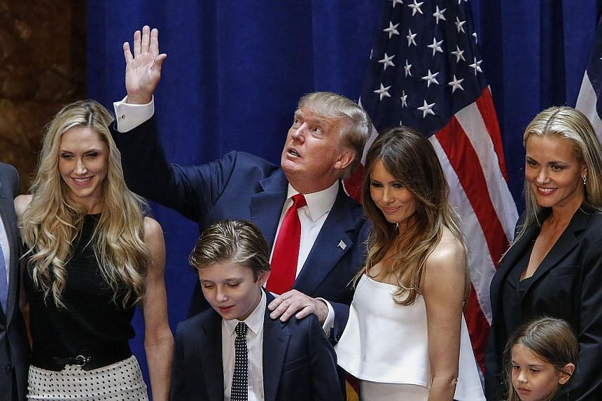 """Real estate developer Donald Trump with his family at the Trump Tower in New York City on Tuesday, after announcing that he will seek the Republican nomination in the 2016 presidential race. The 69-year-old vowed to be """"the greatest jobs president th"""