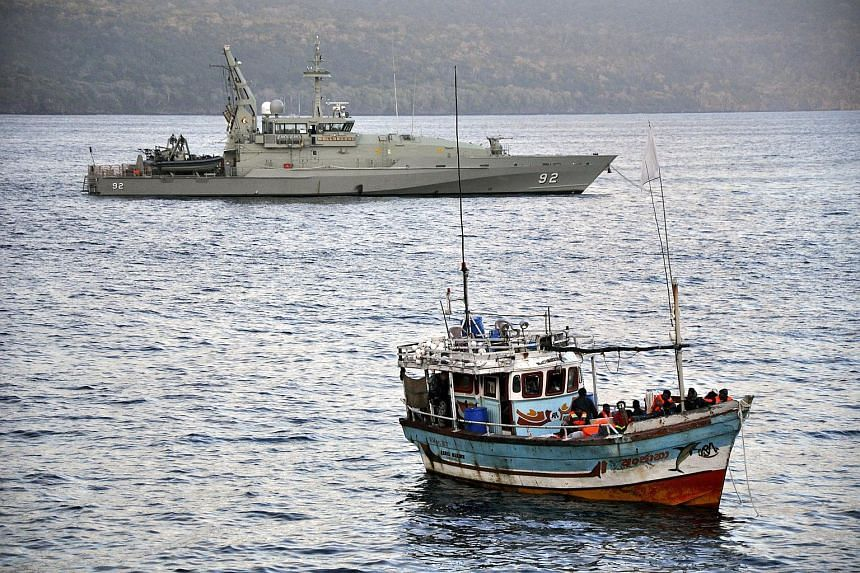 A boat carrying asylum seekers moored in Flying Fish Cove at Australia's Christmas Island on Aug 16, 2012.