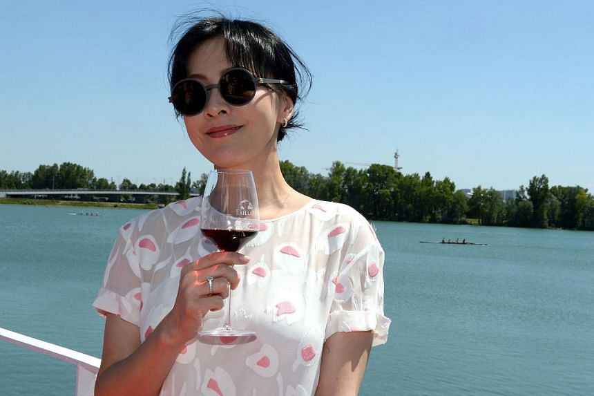 Chinese actress Carina Lau poses during a photocall, before the presentation of her wine products during Vinexpo, the world's biggest wine fair, in Bordeaux, France.