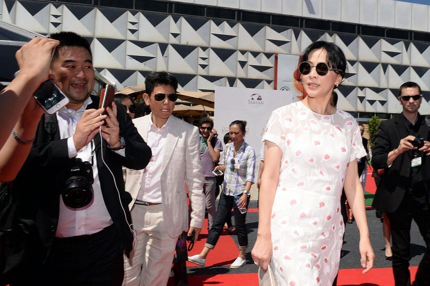 Chinese actress Carina Lau arrives for a photocall, before the presentation of her wine products during Vinexpo, the world's biggest wine fair, in Bordeaux, France.
