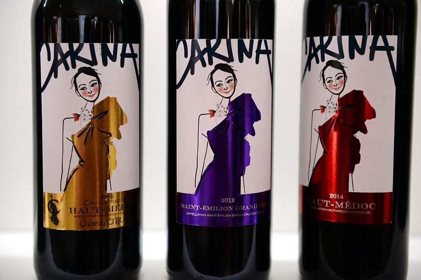 Wine bottles with the effigy of Chinese actress Carina Lau, which can be purchased on internet are pictured during Vinexpo.