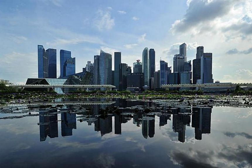 Economists' predictions for Singapore's overall growth are down a little but they now expect the service and construction sectors to take up the slack from manufacturing.