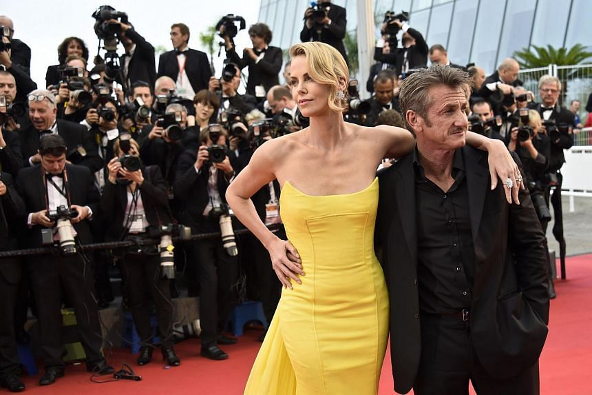 Charlize Theron (left) and Sean Penn at the Mad Max: Fury Road screening in Cannes on May 14, 2015.