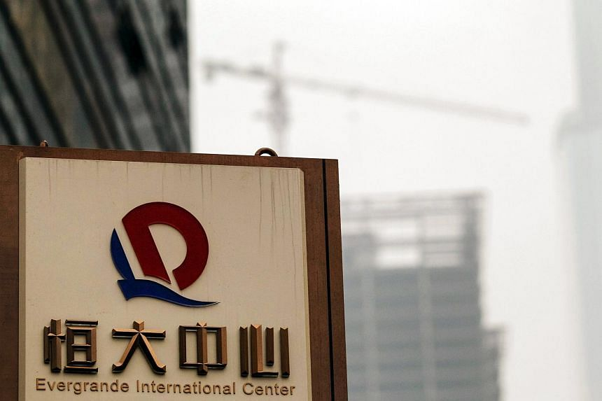 A logo of Evergrande Group is seen in front of a construction site in Guangzhou.