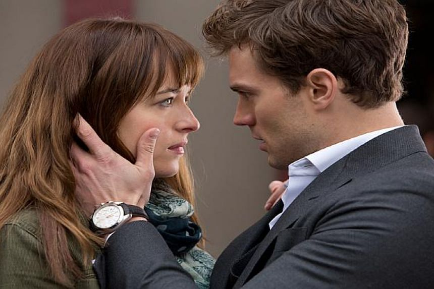 A cinema still from the Fifty Shades Of Grey movie, starring Dakota Johnson (left) and Jamie Dornan.