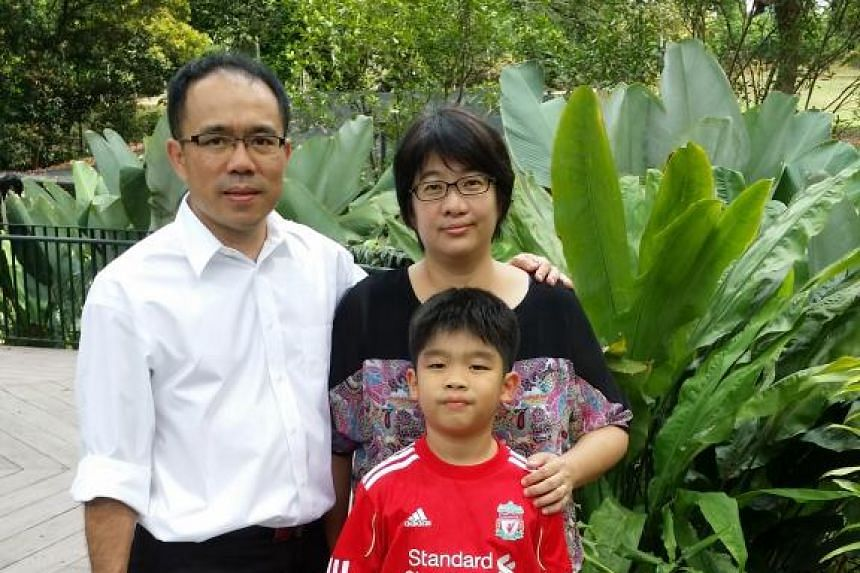 Mr Sim Lim Onn with his wife and son. The permanent resident's wish for Singapore is that it stays competitive and prosperous. -- PHOTO: COURTESY OF SIM LIM ONN