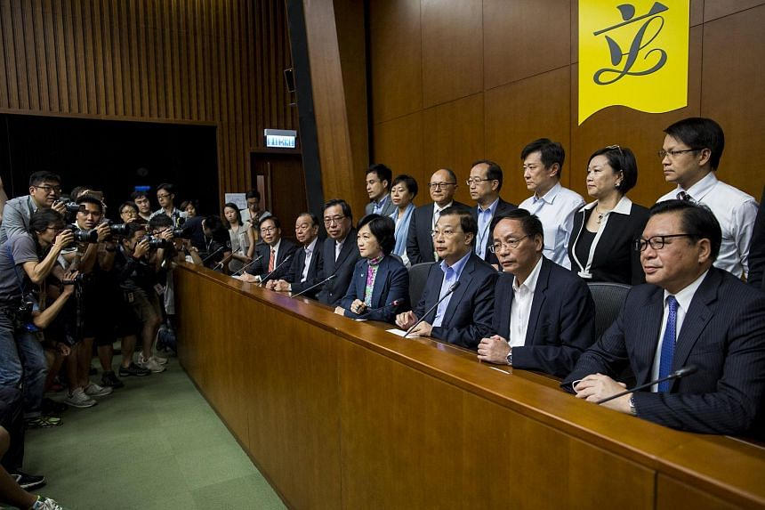 Lawmakers supporting a Beijing-backed electoral reform after voting at the Legislative Council in Hong Kong.