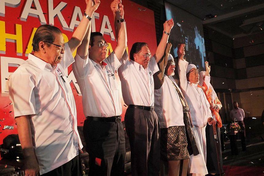Pakatan Rakyat leaders (from left) Lim Kit Siang, Lim Guan Eng, Anwar Ibrahim, Abdul Hadi Awang and Nik Aziz Nik Mat at the alliance's manifesto launch in 2013.