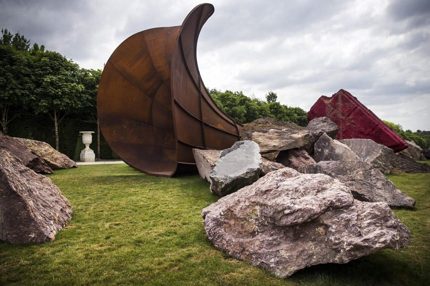 A view of the art installation 'Dirty Corner' by Indian-born British sculptor Anish Kapoor displayed in the gardens of the Palace of Versailles near Paris, France.