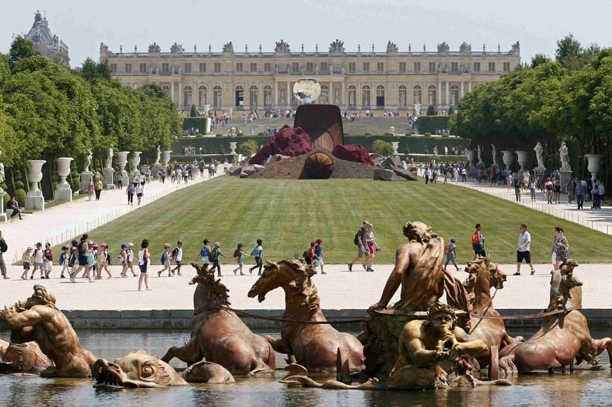 Indian-born British artist Anish Kapoor's 'Dirty Corner' 2011 Cor-Ten steel, earth and mixed media monumental creation is displayed in the gardens of the Chateau de Versailles.