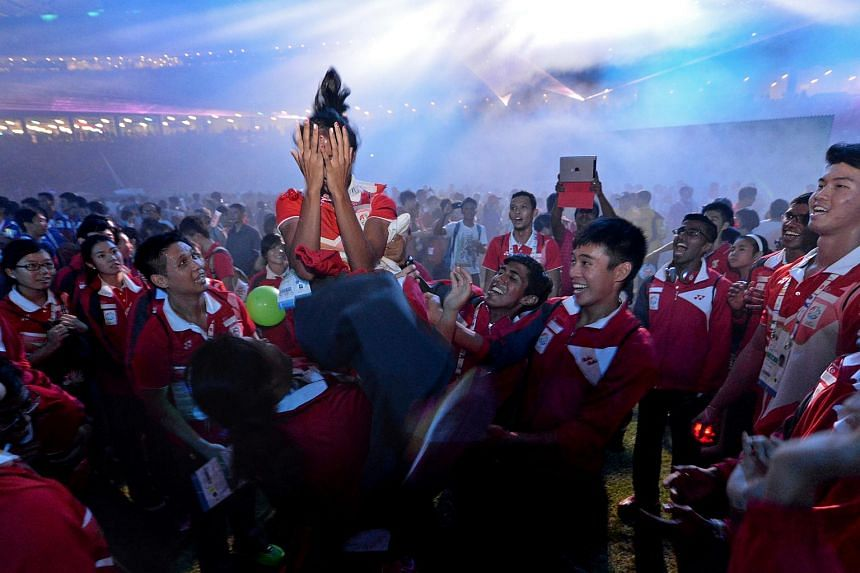 Shanti Pereira is tossed into the air by her Team Singapore teammates at the end of the closing ceremony.