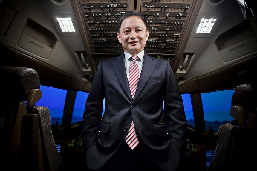 Goh Choon Phong, chief executive officer of Singapore Airlines Ltd., poses for a photograph in a Boeing Co. 777 simulator at the SIA Training Centre in Singapore.