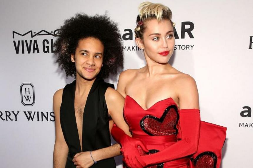 """Singer Miley Cyrus took along Tyler Ford, a photographer and former contestant on The Glee Project, as her """"agender"""" date to the amfAR Inspiration Gala in New York on Tuesday. On Instagram, she described Tyler as a """"queer, biracial, agender per"""