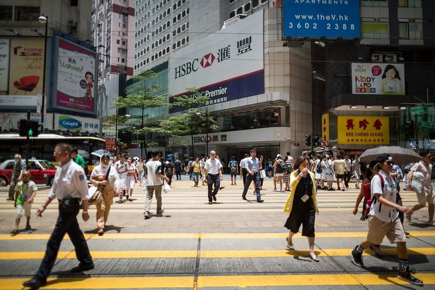 Hong Kong (above) is the world's second-most expensive place for expats, while Singapore is No. 4.