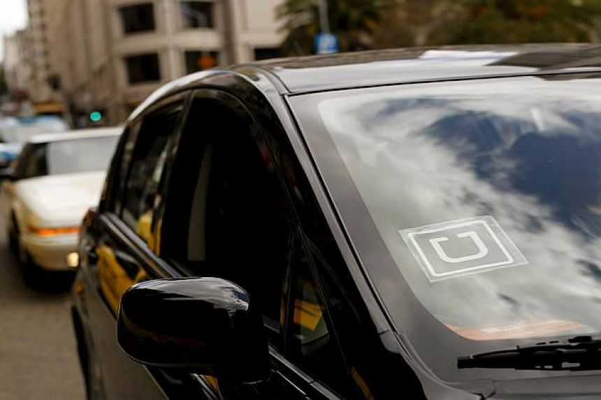 The Uber logo is seen on a vehicle near Union Square in San Francisco, California.