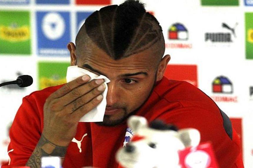 Arturo Vidal sobbed at a press conference in Santiago.