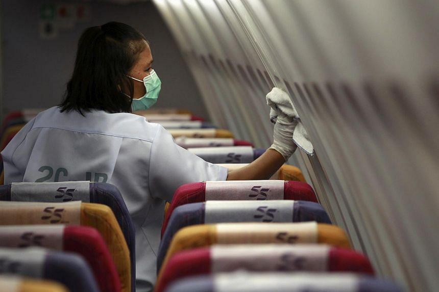 A  worker cleaning the cabin of an aircraft at Bangkok's Suvarnabhumi International Airport on June 18, 2015.