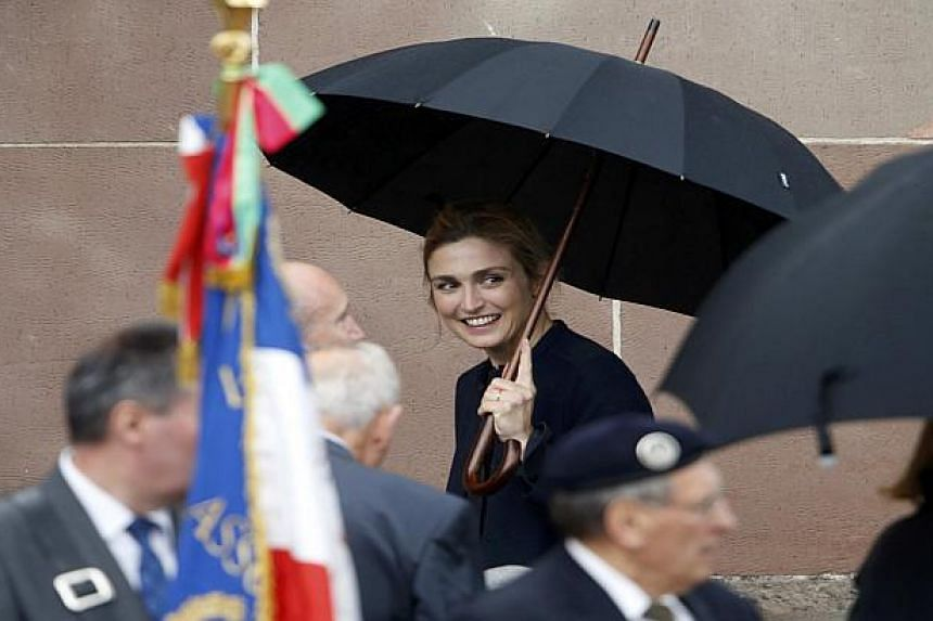 Julie Gayet (centre) appeared for the first time on Thursday at an official event attended by President Francois Hollande.