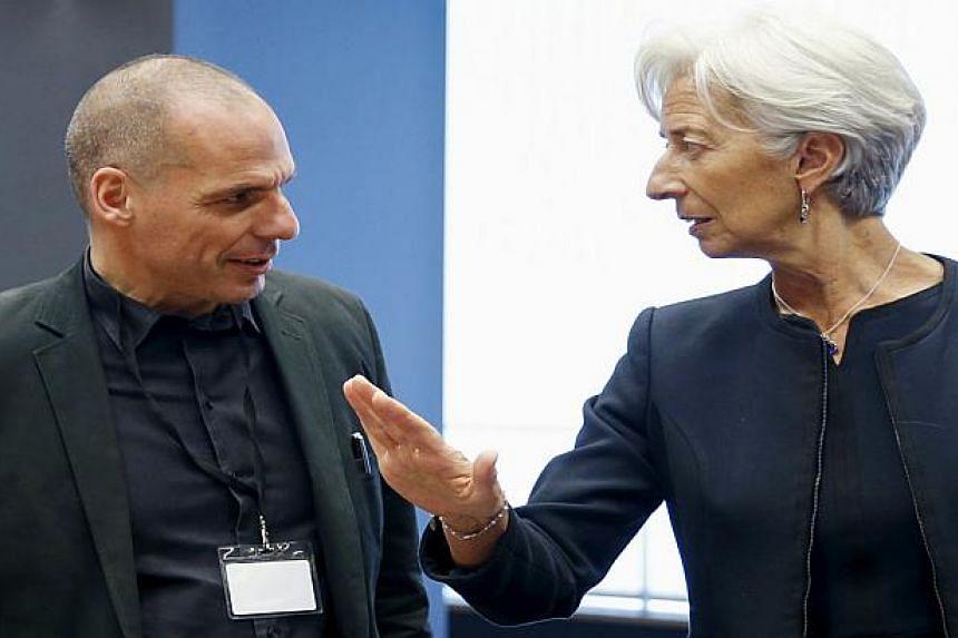 Yanis Varoufakis (left) talking to Christine Lagarde at the June 18, 2015, meeting.