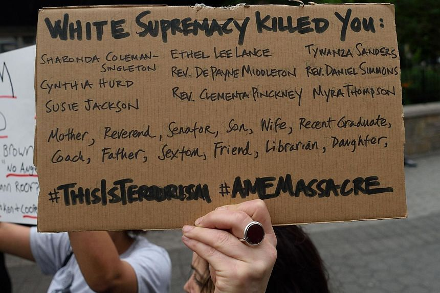 Mourners gathering in New York's Union Square Park on June 18 to remember those killed at a prayer meeting in Charleston.