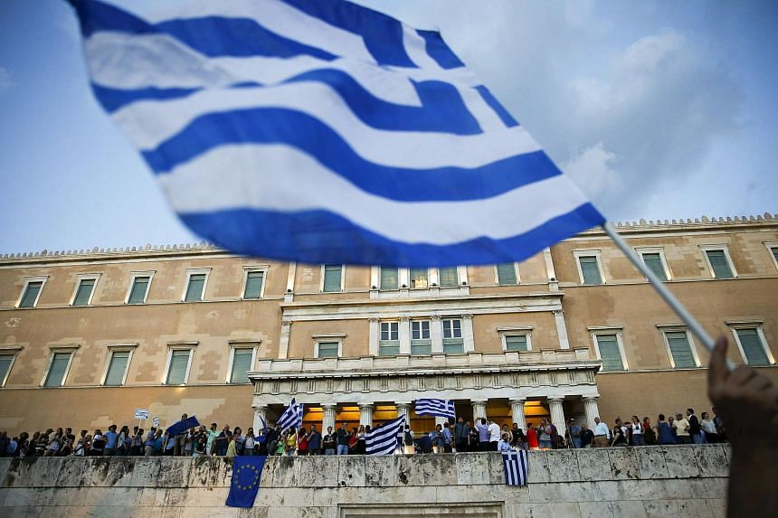 Protesters in Athens calling on the Greek government to clinch a deal with creditors and secure the country's future in the Eurozone.