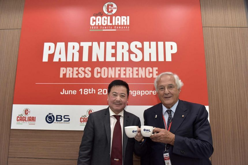 Mr Richmond Te, group assistant general manager of Owl International, and Mr Alberto Cagliari, president of Caffe Cagliari, toasting their new venture.