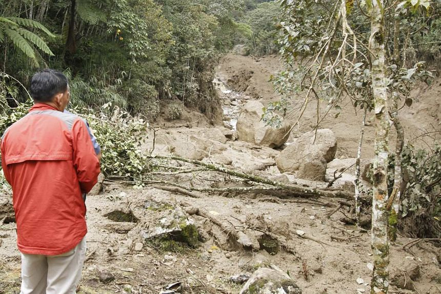 A path to the Mesilau Nature Centre is damaged by a massive mudflow, which has blocked roads into Kiau and Mesilau.