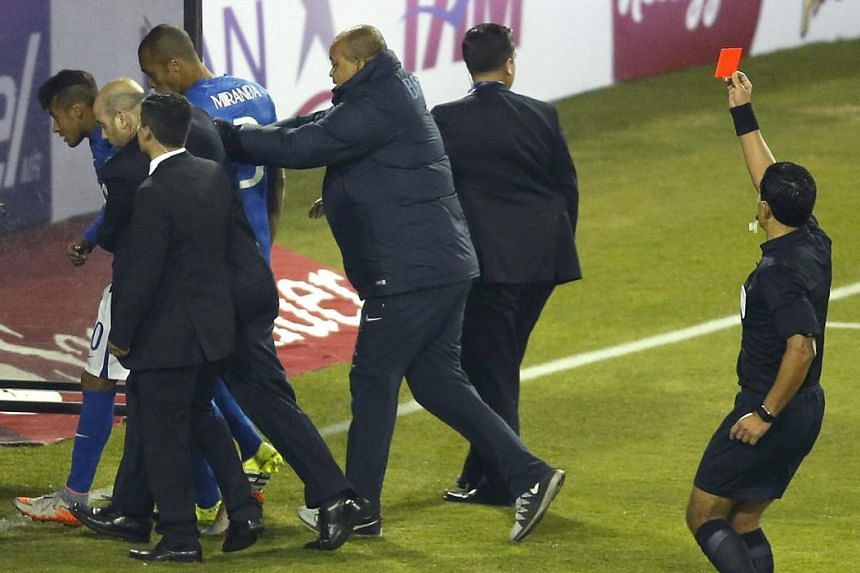 DISMISSAL: Chilean referee Enrique Osses showing a red card to Neymar (left), who is likely to be banned for two games.