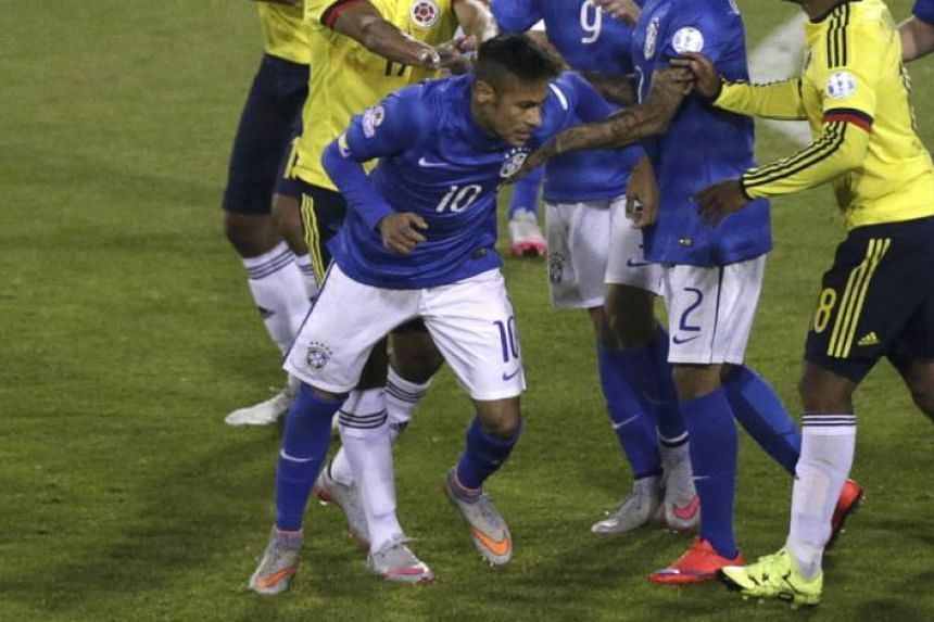 RETALIATION: Neymar is pushed by Colombia's Carlos Bacca after he had head-butted Jeison Murillo.