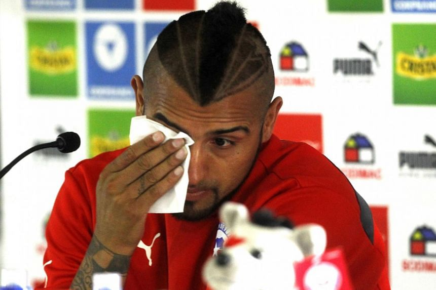 A teary Arturo Vidal said he was embarrassed and asked for forgiveness. His wife was hurt in the crash.
