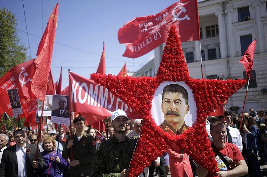 People carrying a portrait of Soviet leader Josef Stalin as they marked the 70th anniversary of the end of World War II last month in Sevastopol city, the subject of a territorial row between Russia and Ukraine.