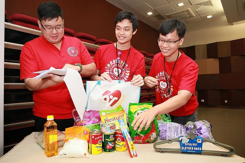 Mr Wong Woei Luen, Mr Teo Si Jie and Mr Elvis Chong checking items - daily necessities - to be added to the funpacks for Jurong Spring residents. Different constituencies have come up with their own ideas on what to add to the funpacks.