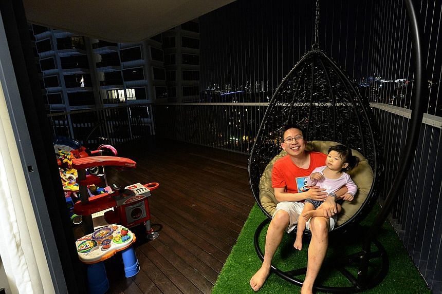 Mr Mark Liu (with his two-year-old daughter) likes that his hardy swinging chair gives his balcony a resort feel.