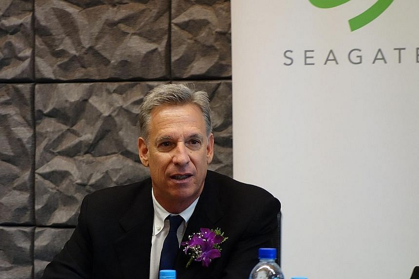 The Singapore Seagate Design Centre (above) will focus on developing a new generation of 2.5-inch storage drives, as the firm makes the most of Singapore's cutting-edge facilities, says chairman Stephen Luczo (right).