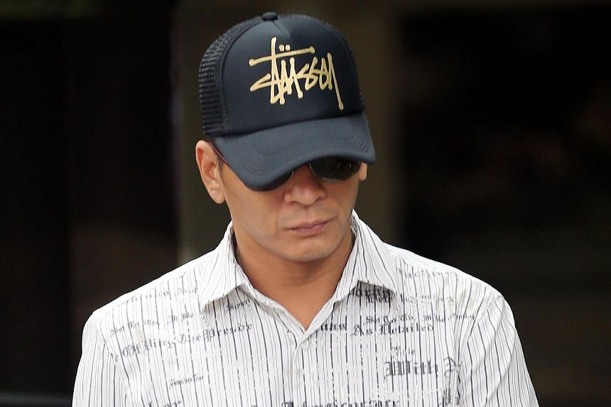 Koh Guan Seng (above), Kelvin Lim Zhi Wei, Kam Kok Keong and Lim Hong Ching, employees of the now-defunct Mobile Air phone shop, have been charged with cheating.