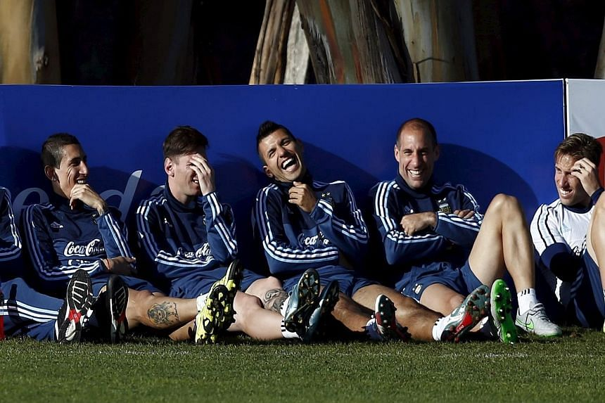 (From left) Argentina players Angel di Maria, Lionel Messi, Sergio Aguero and Pablo Zabaleta relaxing at a training session for the Copa America. While striker Aguero admits that he has tried to persuade Messi to leave Barcelona and join him at Manch