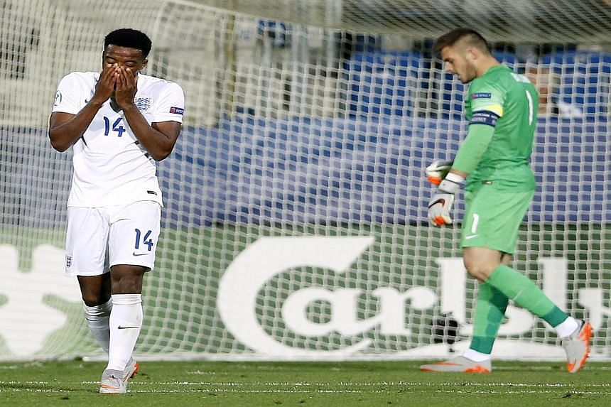 Nathaniel Chalobah and Jack Butland are downcast after England's 0-1 defeat by Portugal in the Czech Republic. They need to end their 10-match winless streak in the European Under-21 Championship against Sweden to stand a decent chance of progressing