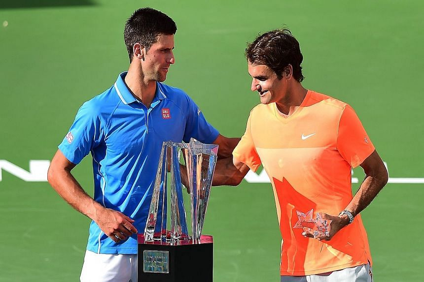 Novak Djokovic (left) and Roger Federer chatting before the trophy presentation for the BNP Paribas Open in Indian Wells, California in March, when the Serb won 6-3, 6-7 (5-7), 6-2. The Swiss legend says that while the great rivals are not close, the