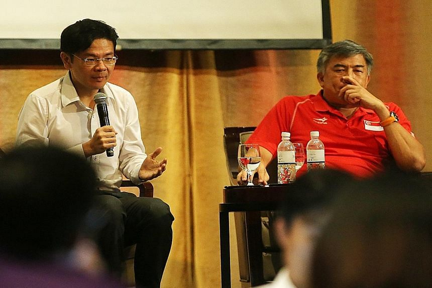 Minister Lawrence Wong (left), with Sport Singapore chief executive officer Lim Teck Yin, says it is not a simple matter of hosting a major event just because Singapore has the facilities. Other factors to consider include whether there are pay-offs