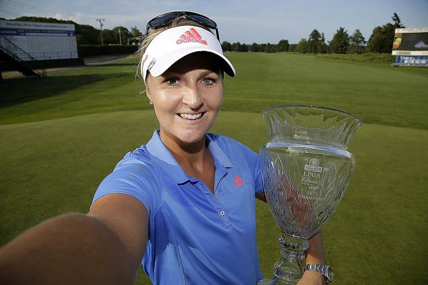 (Left) Anna Nordqvist gave her mum a memorable Swedish Mother's Day when the latter witnessed the golfer's triumph in the ShopRite LPGA Classic in New Jersey on May 31. (Right) A picture of the smashed trophy.
