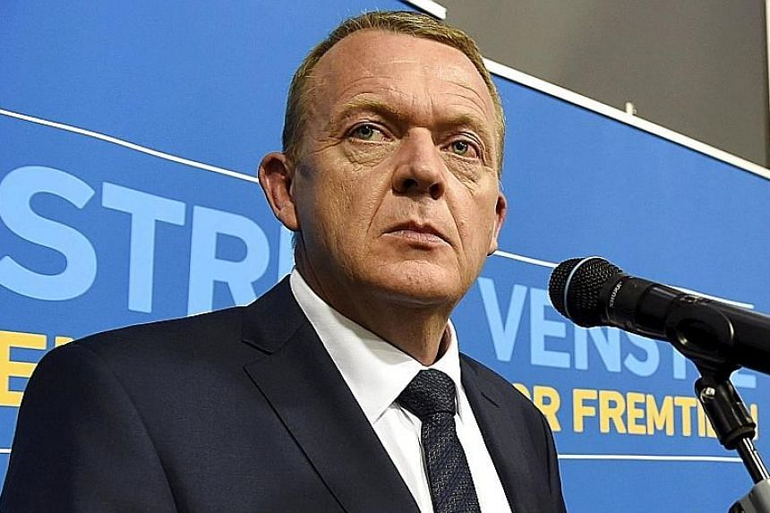 Liberal Party leader Lars Lokke Rasmussen (above) is expected to become prime minister, although the Danish People's Party of Mr Kristian Thulesen Dahl (right) is the winning bloc's biggest group.