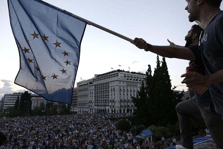 Greek demonstrators outside Parliament calling for the country to remain in the euro zone.
