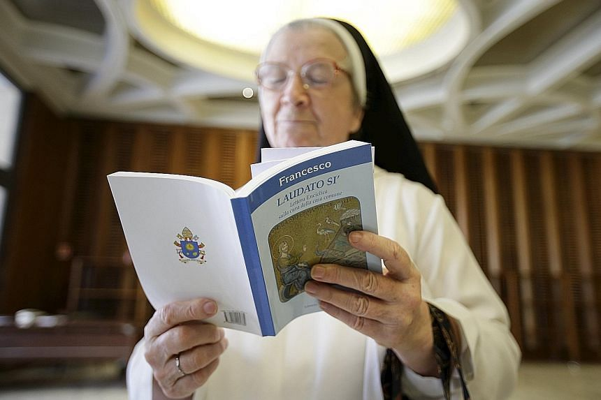 A nun reading Pope Francis' controversial encyclical in the Vatican. In the document, the pontiff says that everyone and everything is connected - to God, to creation, to fellow human beings.