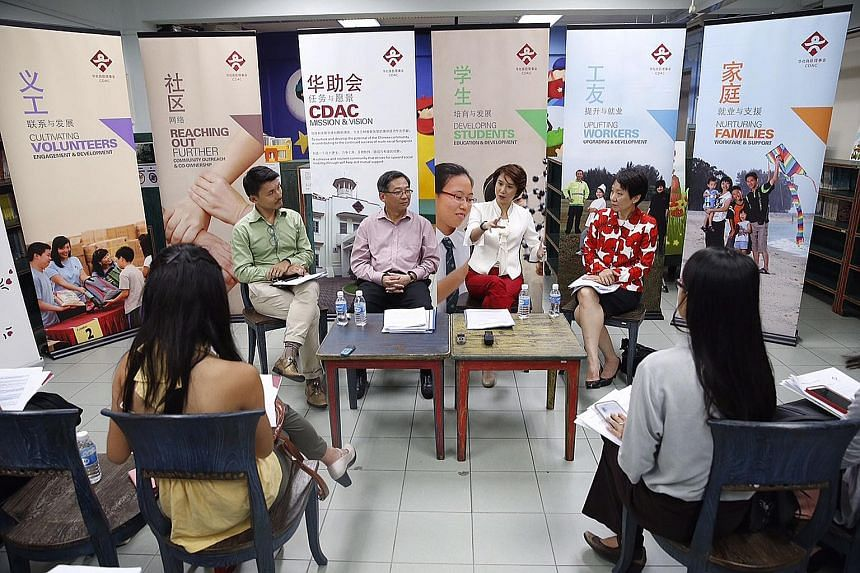Mr Baey Yam Keng (from left), chairman of CDAC's volunteers committee, Mr Gan Kim Yong, CDAC's board chairman, and board members Low Yen Ling and Grace Fu meeting reporters after the council's 23rd AGM yesterday.
