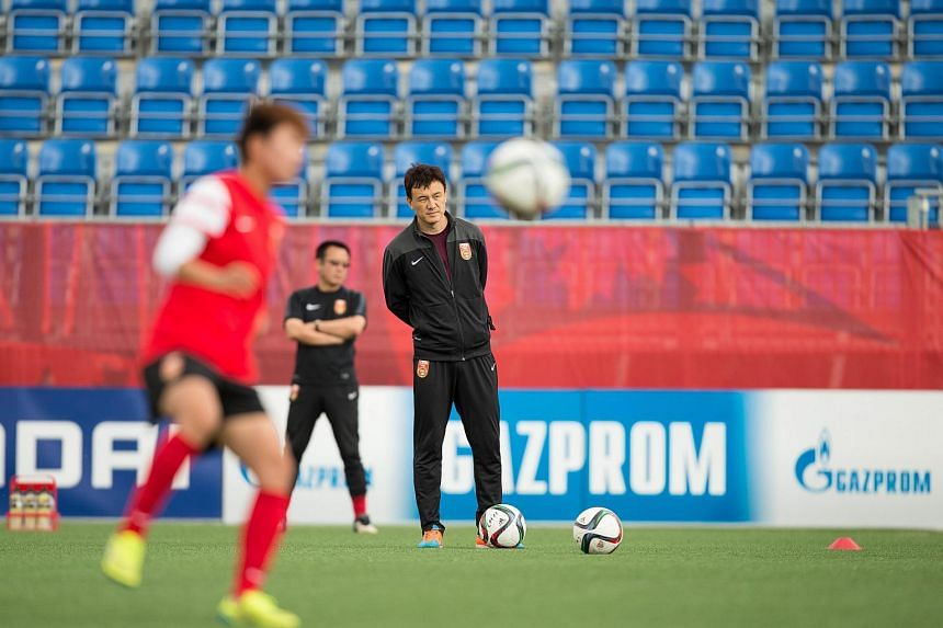 China's head coach Hao Wei looking on during a practice session in Edmonton, Canada.