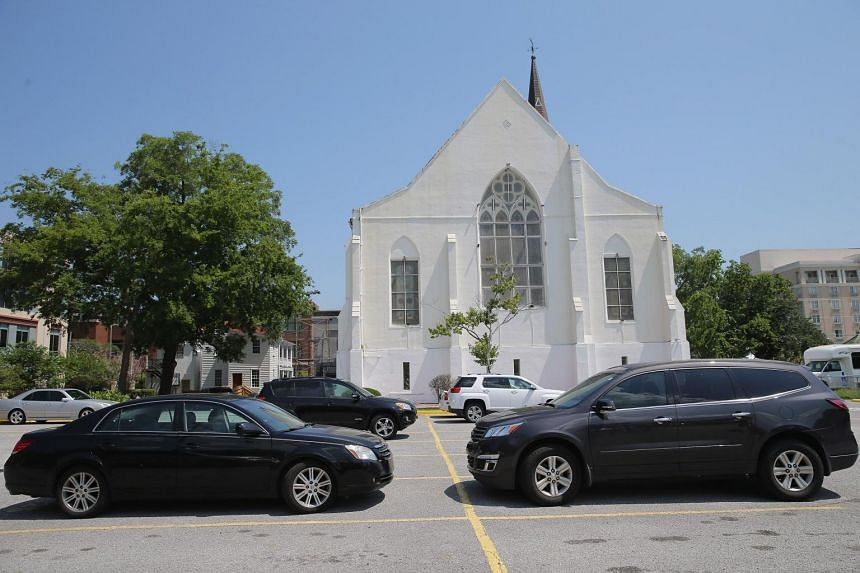Cars belonging to some of the nine victims of the shooting are still in the parking lot at the Emanuel African Methodist Episcopal Church on June 19, 2015.